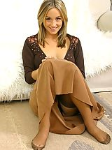 Tiny Breasts, Melanie in a revealing brown top and long brown dress.