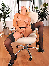 Small Boobs, Seductive Anilos mom in sheer black lingerie masturbates in her office chair
